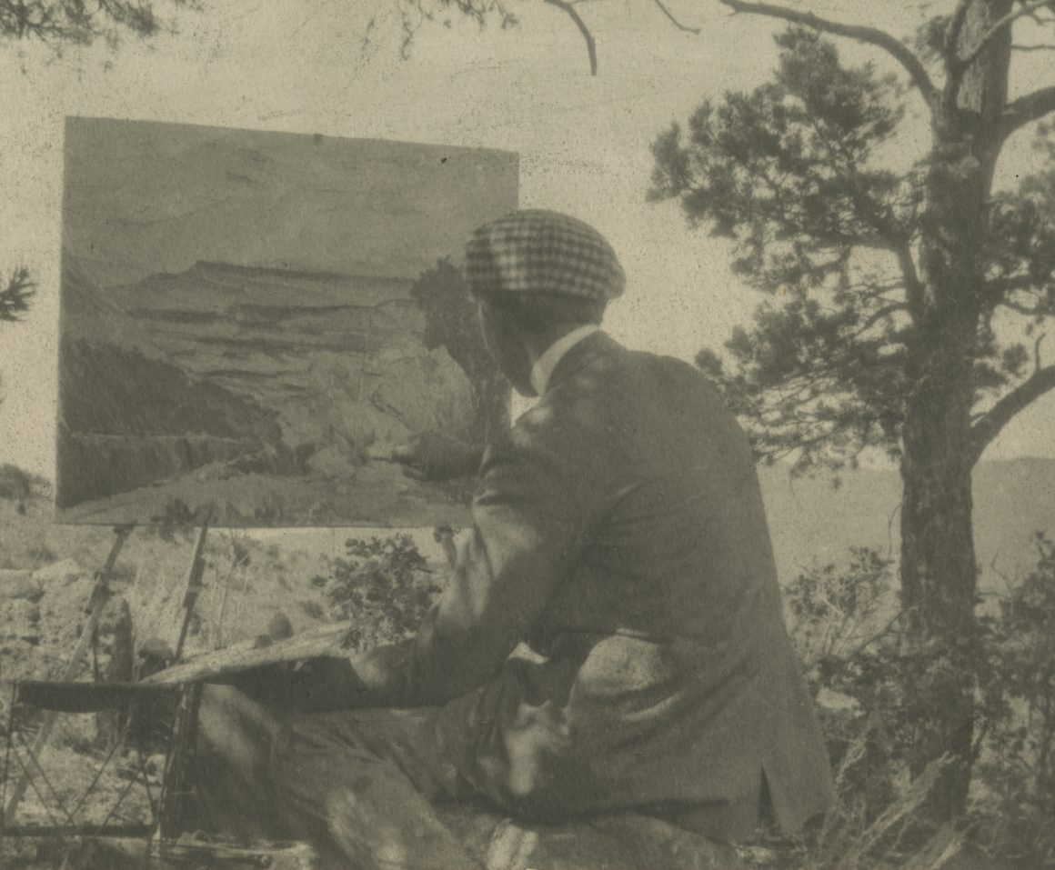 A black and white photograph of Raymond Jonson painting in Colorado.