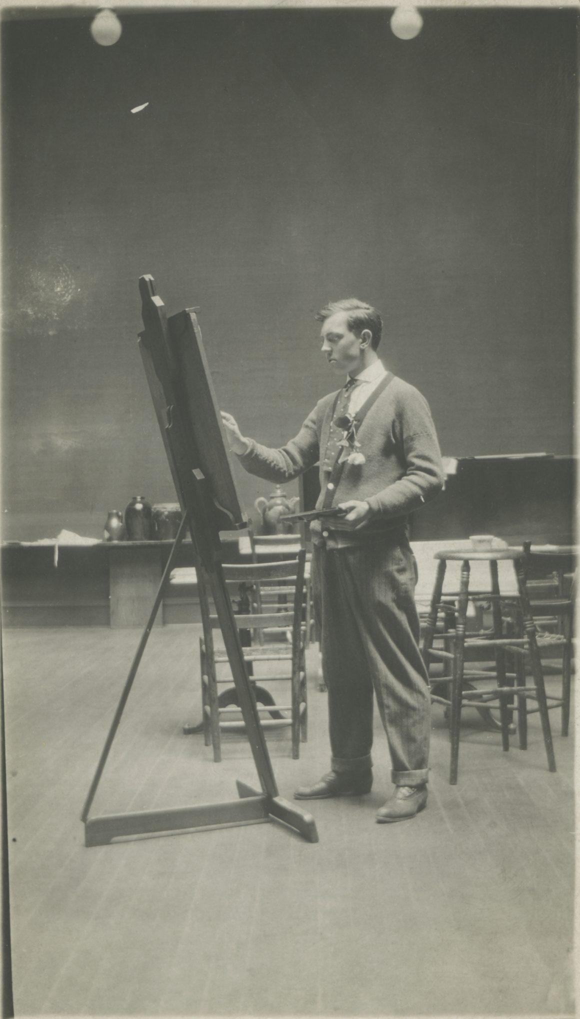 Black and white photograph of Raymond Jonson painting at the Portland Art School.