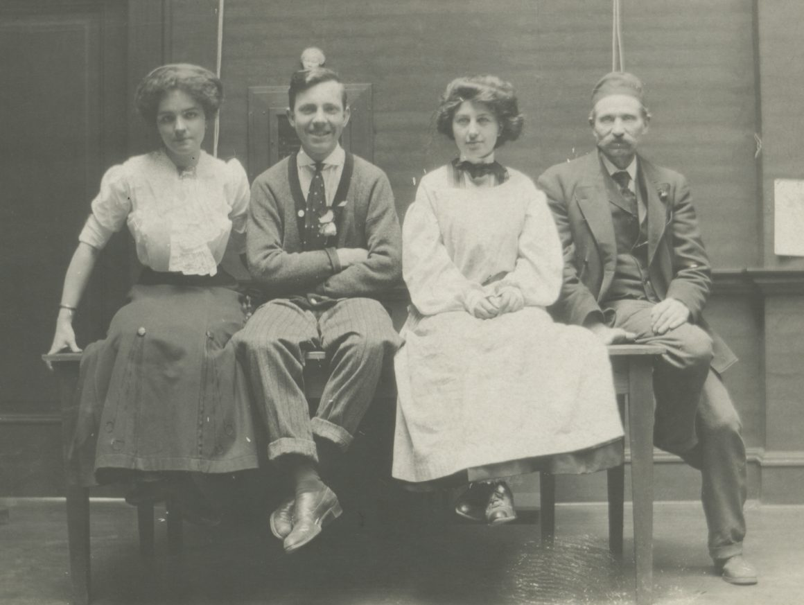 Black and white photograph of four people seated at the Portland Art Museum, 1910.