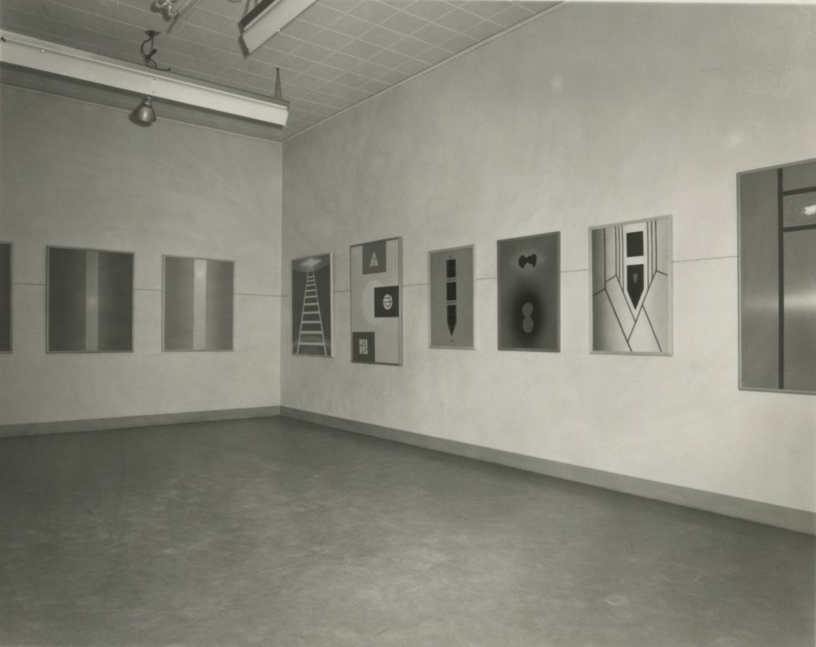 Photograph of the interior of Jonson Gallery with paintings by Jonson paintings on display in 1967.