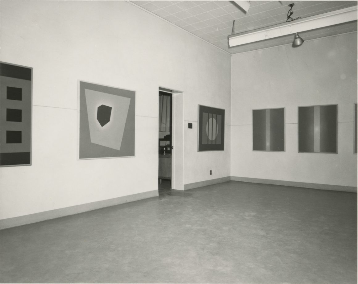 Black and white photograph of a corner of the Jonson Gallery in 1967.